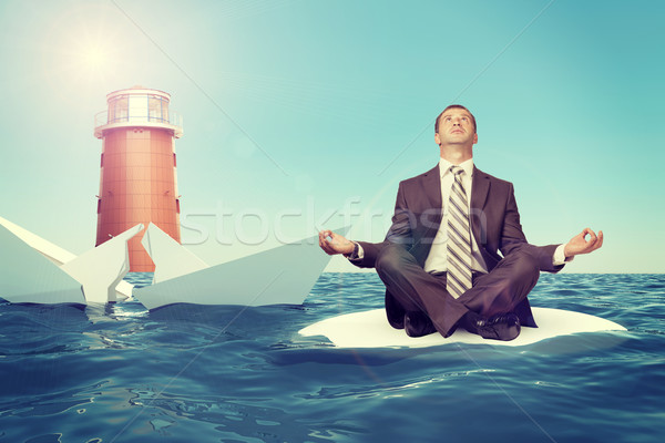 Businessman with sinking broken ship Stock photo © cherezoff