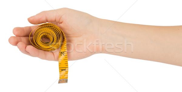 Humans arm holding tape measure Stock photo © cherezoff