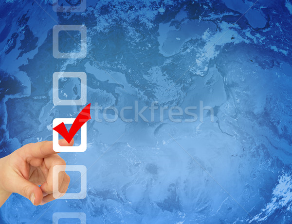 Hand pointing to the checkbox Stock photo © cherezoff