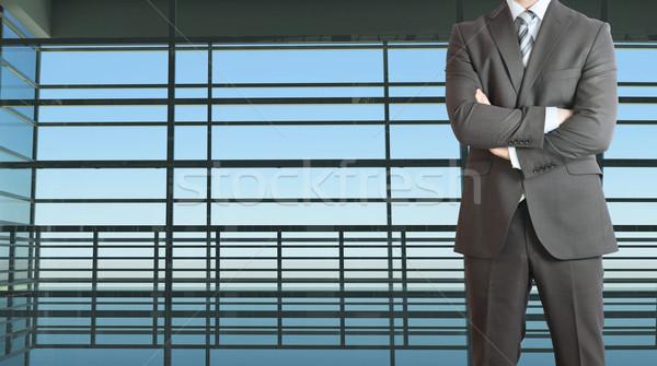Businessman and large window airport terminal Stock photo © cherezoff
