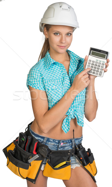 Woman in hard hat and tool belt showing calculator Stock photo © cherezoff