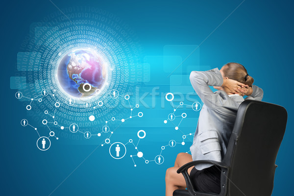 Businesswoman looking at virtual interface Stock photo © cherezoff