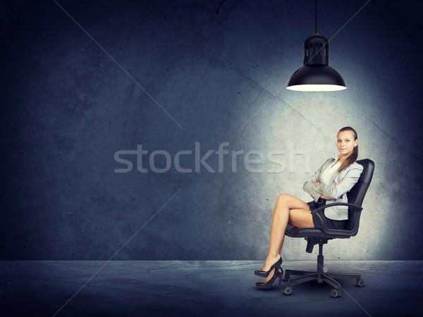 Nő visel kabát blúz ül lábak keresztbe Stock fotó © cherezoff