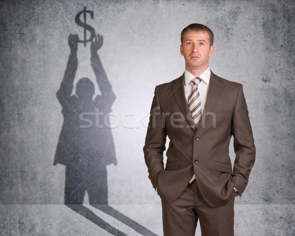 Işadamı gölge dolar işareti duvar doku Stok fotoğraf © cherezoff