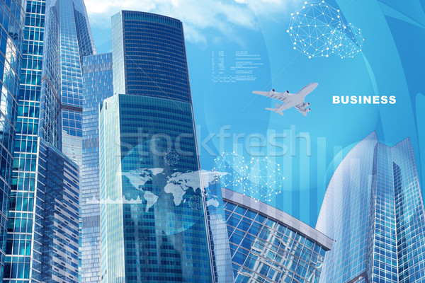 High-rise buildings with world map Stock photo © cherezoff