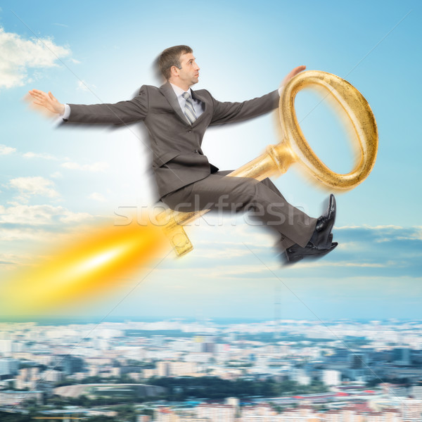 Businessman flying on key Stock photo © cherezoff