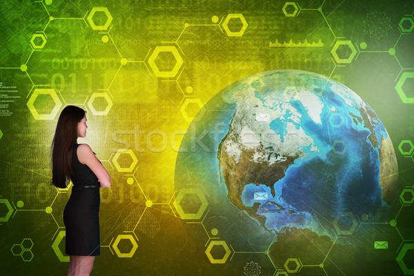 üzletasszony holografikus képernyő Föld földgömb számok Stock fotó © cherezoff