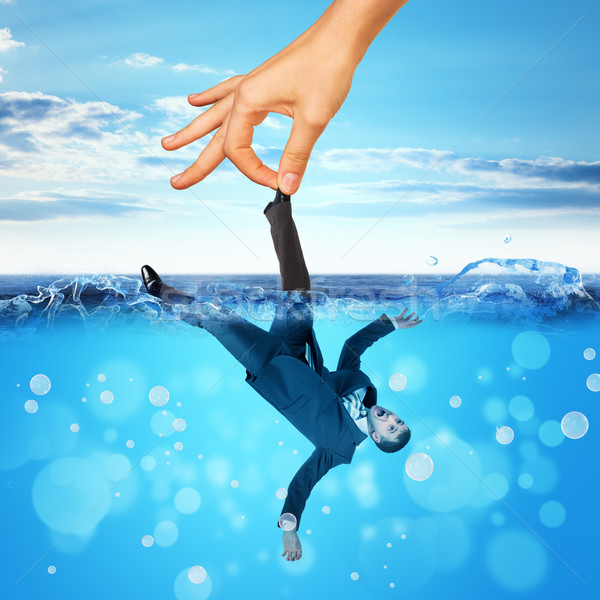 Businessman drowning in sea Stock photo © cherezoff