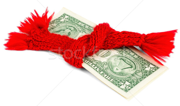 Dollar wrapped in a red scarf. Isolated Stock photo © cherezoff