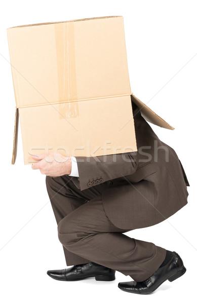 Businessman in suit wearing carton box on head Stock photo © cherezoff