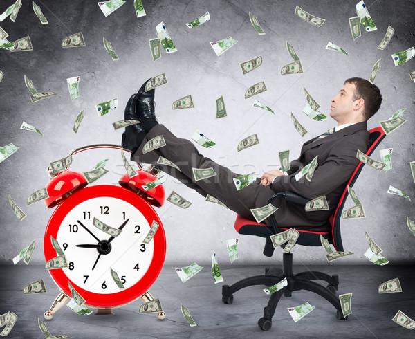 Tijd is geld zakenman klok geld regen gezicht Stockfoto © cherezoff