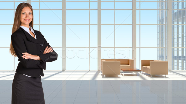Businesswoman and large window in office building Stock photo © cherezoff