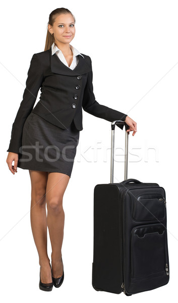 Businesswoman with wheeled travel bag, looking at camera, smiling Stock photo © cherezoff