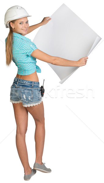 Woman in hard hat showing blank sheet of drawing paper Stock photo © cherezoff