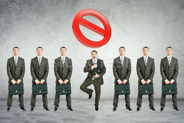 Ayarlamak işadamları büyük sıfır gri duvar Stok fotoğraf © cherezoff