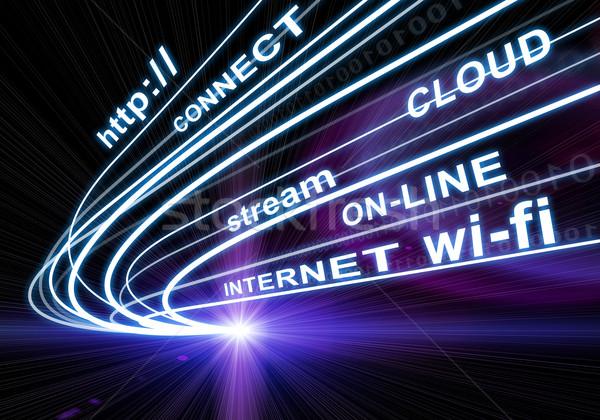 Stream of light beams, digits and words  internet, on-line etc. on dark background Stock photo © cherezoff