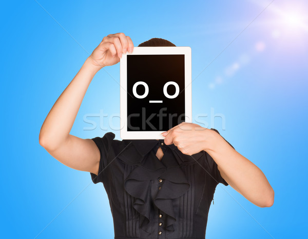 Young girl in black dress covered her face with tablet. On screen surprised smiley Stock photo © cherezoff