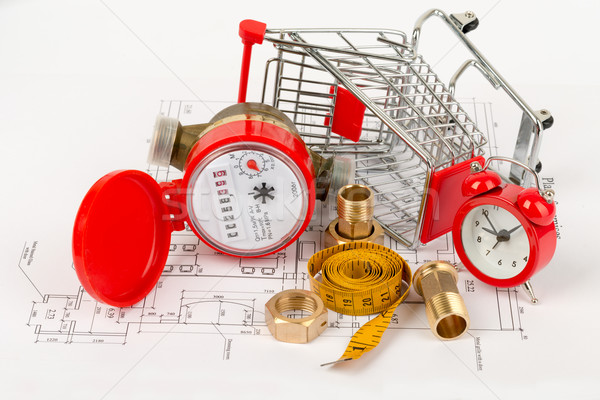 Water meter with shopping cart and pipe fittings Stock photo © cherezoff