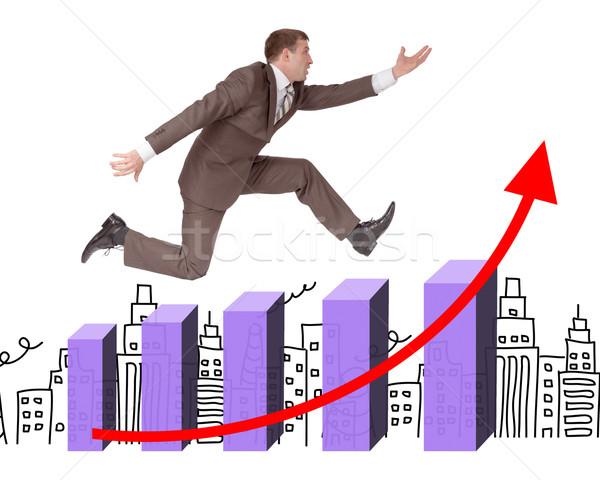 Businessman running with hand forward on chart Stock photo © cherezoff