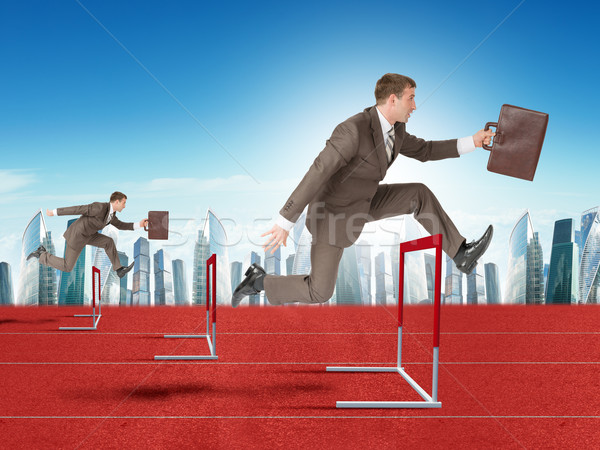 Men hopping over treadmill barrier with city Stock photo © cherezoff