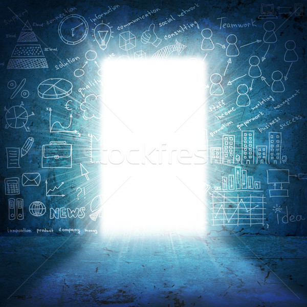 In concrete wall doorway with bright light and business sketches Stock photo © cherezoff
