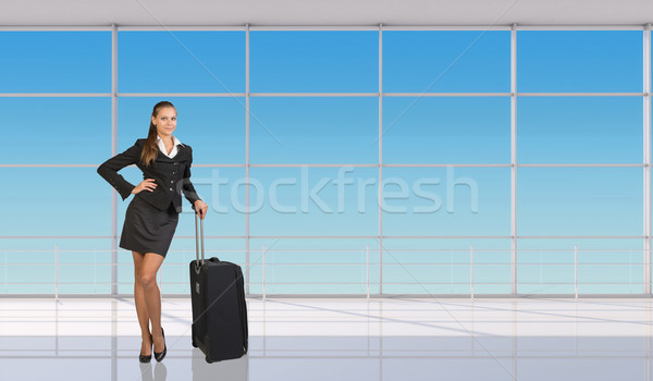 Smiling flight attendant standing with luggage Stock photo © cherezoff