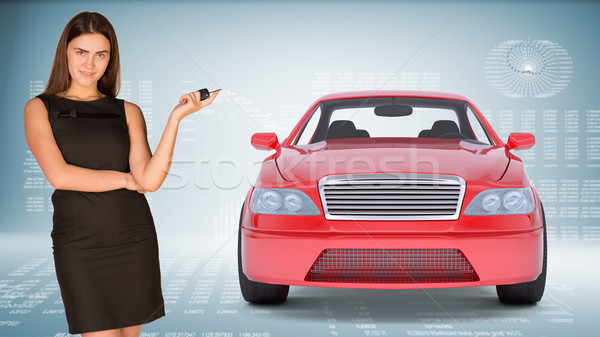 Businesslady holding car key Stock photo © cherezoff