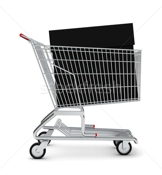 Black bag in shopping cart Stock photo © cherezoff