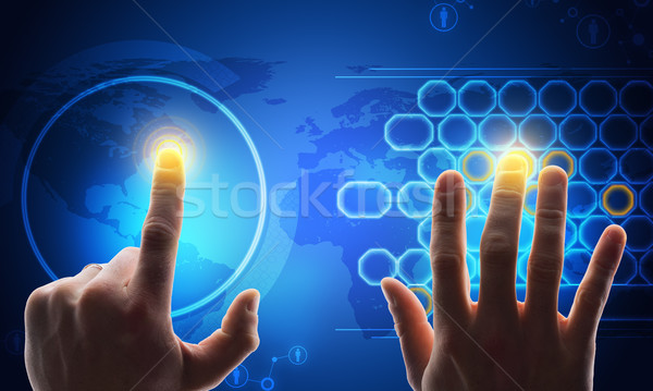 Humans hands touching blue holographic screen Stock photo © cherezoff