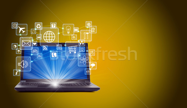 Laptop with lightspot and icons Stock photo © cherezoff