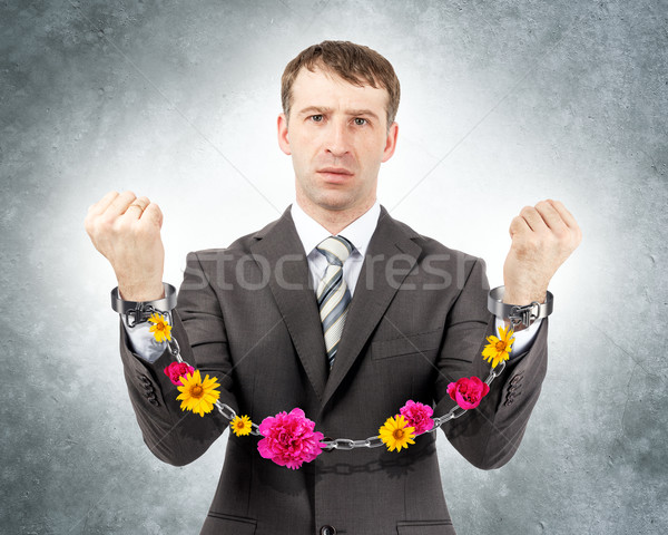 Businessman in cuffs with flowers Stock photo © cherezoff