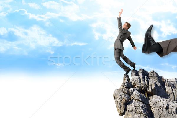 Businessman kicked by his boss big foot Stock photo © cherezoff