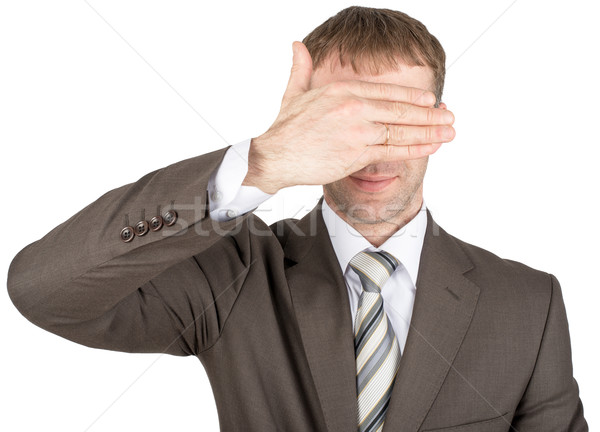 Man closes eyes with his hand Stock photo © cherezoff