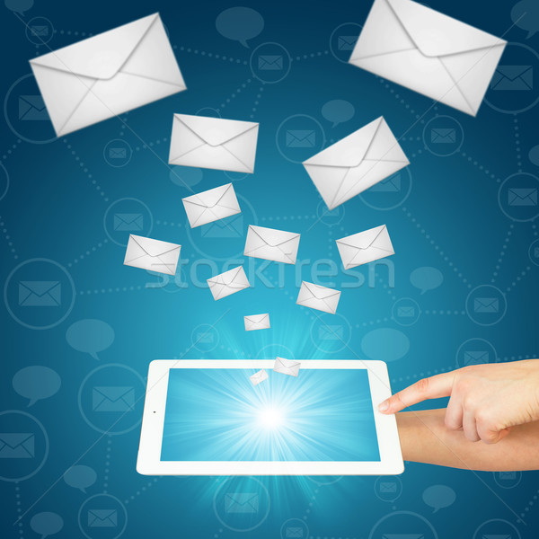 Hand, tablet pc and envelopes Stock photo © cherezoff