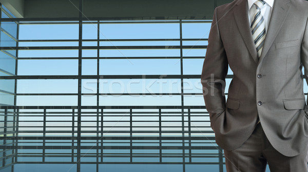 Businessman and large window airport terminal Stock photo © cherezoff