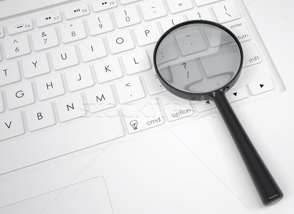 Magnifier glass on the keyboard Stock photo © cherezoff