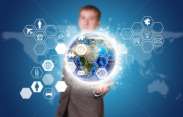 ストックフォト: ビジネスマン · スーツ · ホールド · 地球 · アイコン · 要素