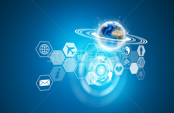 Earth and transparent hexagons with icons Stock photo © cherezoff