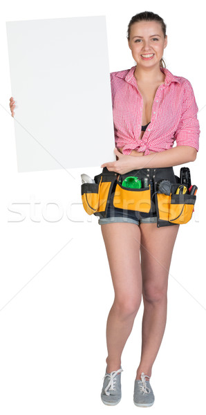 Woman in tool belt showing blank banner Stock photo © cherezoff