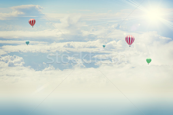 Lövés repülőgép felhők nap hőlégballon Stock fotó © cherezoff