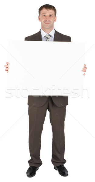 Businessman behind blank paper Stock photo © cherezoff