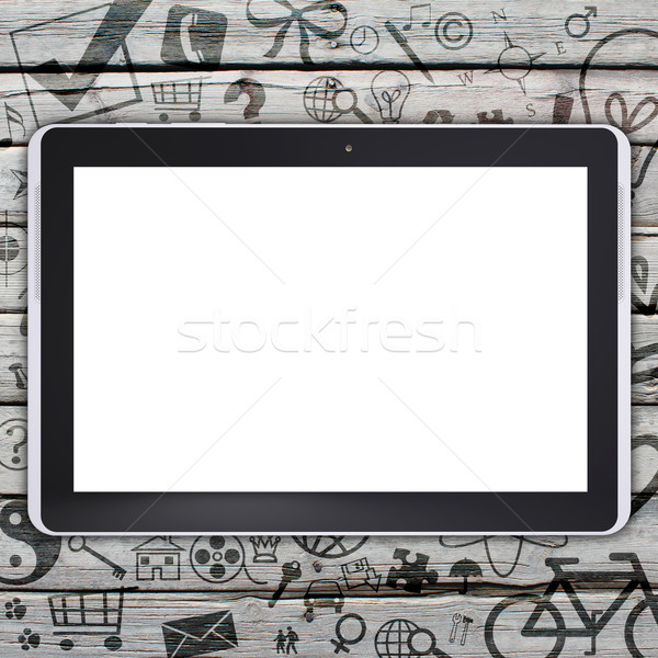 Tablet PC on an old wooden surface Stock photo © cherezoff