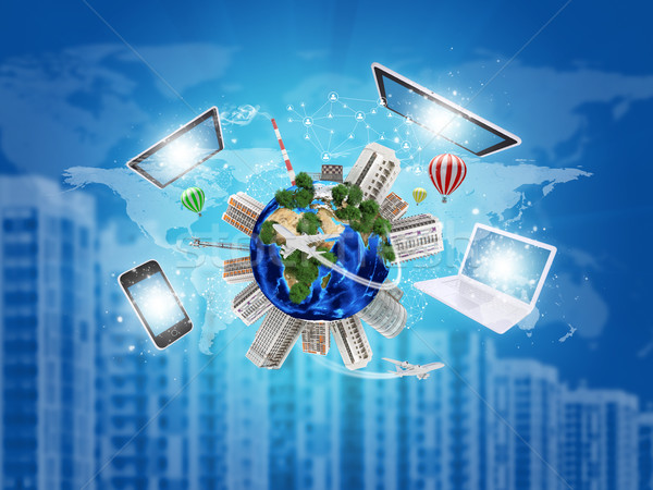 Earth with buildings on surface. Laptop, tablet pc and phone Stock photo © cherezoff
