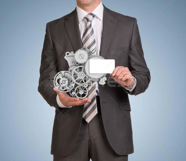 Businessman hold empty card and clockwork Stock photo © cherezoff