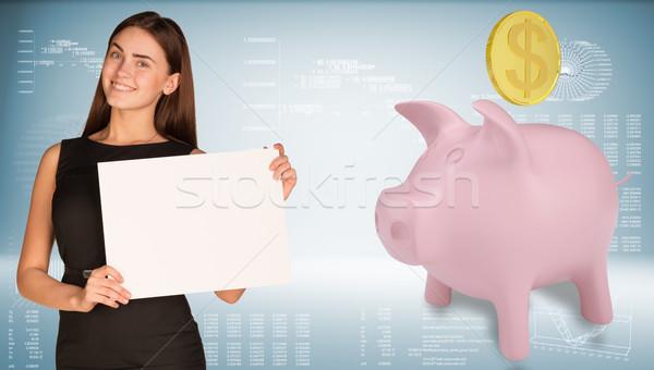 女性実業家 ホールド 紙 シート ピンク 貯金 ストックフォト © cherezoff