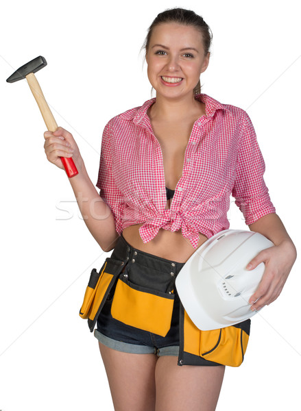 Woman in tool belt holding hard hat and hammer Stock photo © cherezoff
