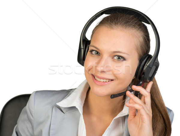 Businesswoman in headset, with her fingers on microphone boom Stock photo © cherezoff