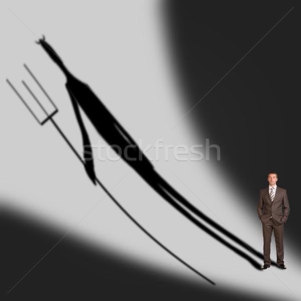 Imprenditore demon ombra grigio muro Foto d'archivio © cherezoff
