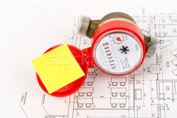 Water meter with yellow sticker on draft Stock photo © cherezoff
