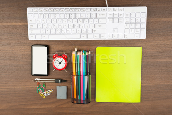 Keyboard with office supplies Stock photo © cherezoff